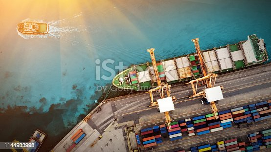 istock Logistics and transportation of Container Cargo ship and Cargo plane with working crane bridge in shipyard at sunrise, logistic import export and transport industry background 1144933998