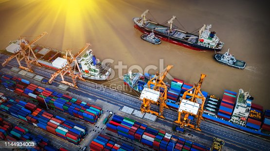 istock Logistics and transportation of Container Cargo ship and Cargo plane with working crane bridge in shipyard at sunrise, logistic import export and transport industry background 1144934003