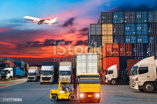 istock Logistics and transportation of Container Cargo ship and Cargo plane with working crane bridge in shipyard at sunrise, logistic import export and transport industry background 1147715064