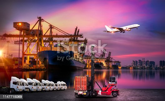 istock Logistics and transportation of Container Cargo ship and Cargo plane with working crane bridge in shipyard at sunrise, logistic import export and transport industry background 1147715069