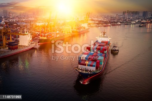 istock Logistics and transportation of Container Cargo ship and Cargo plane with working crane bridge in shipyard at sunrise, logistic import export and transport industry background 1148731993