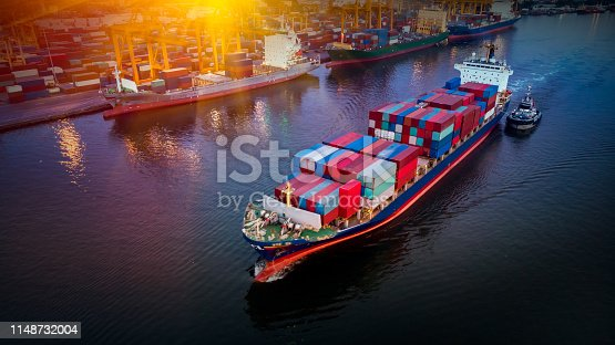 istock Logistics and transportation of Container Cargo ship and Cargo plane with working crane bridge in shipyard at sunrise, logistic import export and transport industry background 1148732004