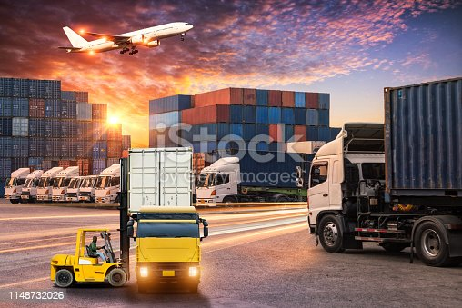 istock Logistics and transportation of Container Cargo ship and Cargo plane with working crane bridge in shipyard at sunrise, logistic import export and transport industry background 1148732026