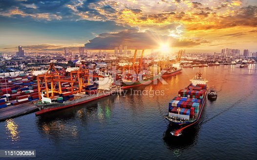 istock Logistics and transportation of Container Cargo ship and Cargo plane with working crane bridge in shipyard at sunrise, logistic import export and transport industry background 1151090884