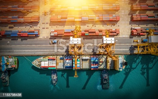 istock Logistics and transportation of Container Cargo ship and Cargo plane with working crane bridge in shipyard at sunrise, logistic import export and transport industry background 1153798438