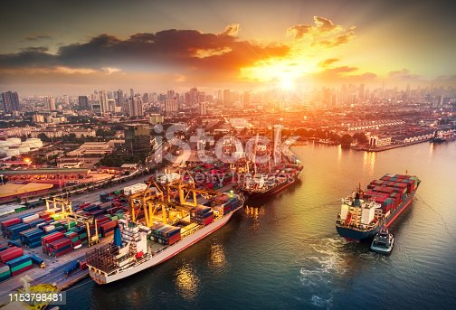 istock Logistics and transportation of Container Cargo ship and Cargo plane with working crane bridge in shipyard at sunset, logistic import export and transport industry background 1153798481