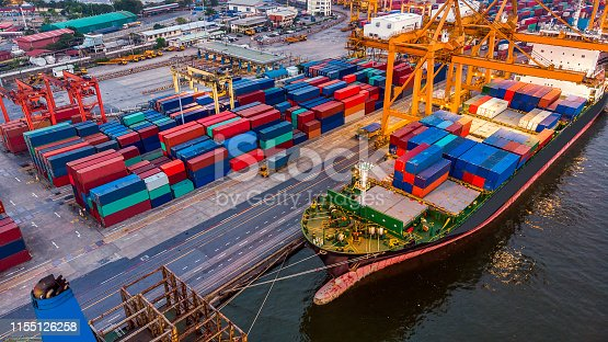 istock Logistics and transportation of Container Cargo ship and Cargo plane with working crane bridge in shipyard, logistic import export and transport industry background 1155126258