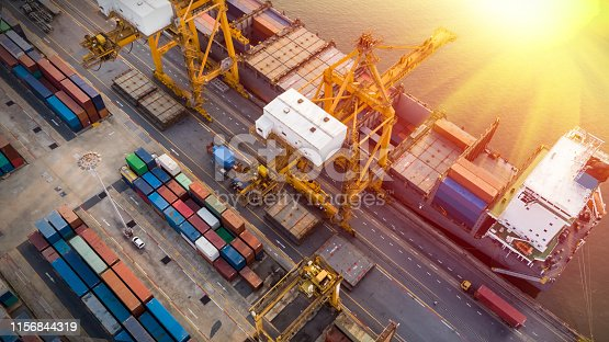 istock Logistics and transportation of Container Cargo ship and Cargo plane with working crane bridge in shipyard at sunset, logistic import export and transport industry background 1156844319
