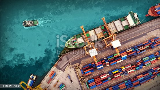istock Logistics and transportation of Container Cargo ship and Cargo plane with working crane bridge in shipyard, logistic import export and transport industry background 1159527038