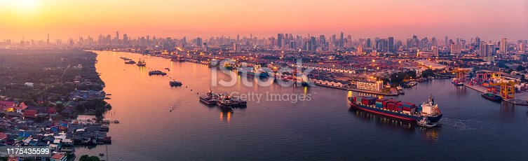 istock Logistics and transportation of Container Cargo ship and Cargo plane with working crane bridge in shipyard at sunrise, logistic import export and transport industry background 1175435599