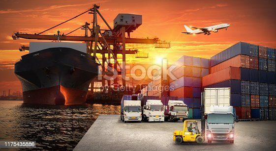 istock Logistics and transportation of Container Cargo ship and Cargo plane with working crane bridge in shipyard at sunrise, logistic import export and transport industry background 1175435886