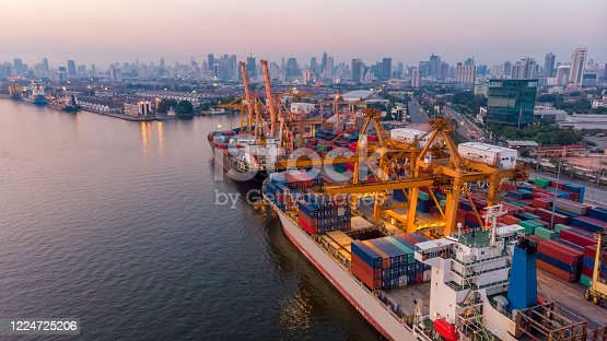 istock Logistics and transportation of Container Cargo ship and Cargo plane with working crane bridge in shipyard at sunrise, logistic import export and transport industry background 1224725206
