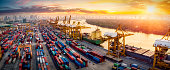 istock Logistics and transportation of Container Cargo ship and Cargo plane with working crane bridge in shipyard at sunrise, logistic import export and transport industry background 1228777319