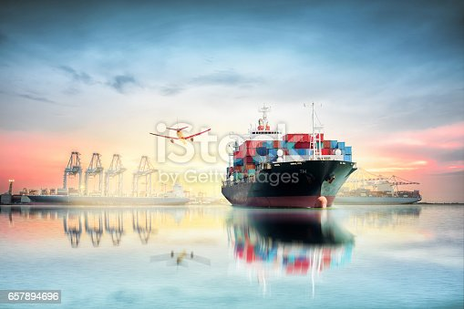 693774520 istock photo Logistics and transportation of Container Cargo ship and Cargo plane with working crane bridge in harbor at Twilight sky, logistic import export background and transport industry. 657894696