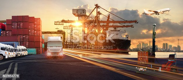 istock Logistics and transportation of Container Cargo ship and Cargo plane with working crane bridge in shipyard 802854778