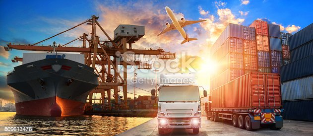 istock Logistics and transportation of Container Cargo ship and Cargo plane with working crane bridge in shipyard 809613476