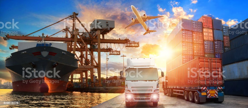 Logistics and transportation of Container Cargo ship and Cargo plane with working crane bridge in shipyard stock photo