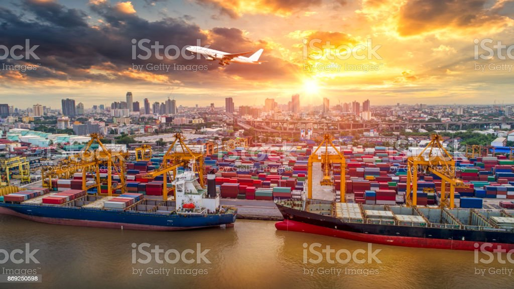 Logistics And Transportation Of Container Cargo Ship Plane With Working Crane Bridge In Shipyard At Sunrise Logistic Import Export Transport