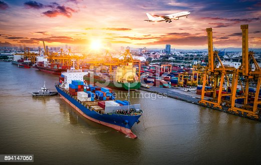 istock Logistics and transportation of Container Cargo ship and Cargo plane with working crane bridge in shipyard at sunrise, logistic import export and transport industry background 894147050