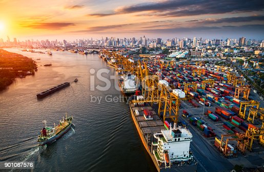 istock Logistics and transportation of Container Cargo ship and Cargo plane with working crane bridge in shipyard at sunrise, logistic import export and transport industry background 901067576