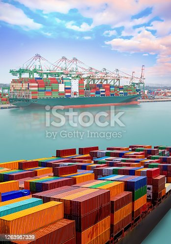 istock Logistics and transportation of International Container Cargo ship at port 1263987339