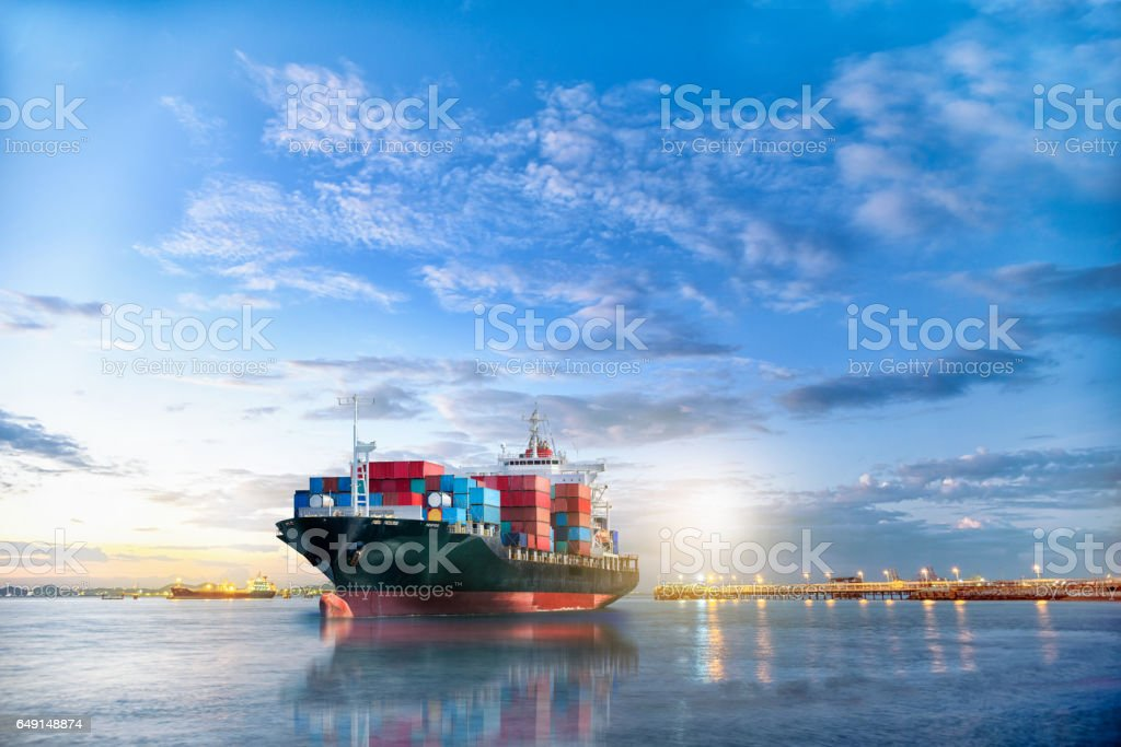 Logistics and transportation of International Container Cargo ship in the ocean at twilight sky, Freight Transportation, Shipping royalty-free stock photo