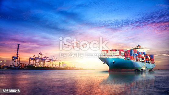 693774520 istock photo Logistics and transportation of International Container Cargo ship in the ocean at twilight sky, Freight Transportation, Shipping 656489648