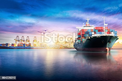 693774520 istock photo Logistics and transportation of International Container Cargo ship in the ocean at twilight sky, Freight Transportation, Shipping 664226310