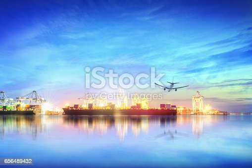 693774520 istock photo Logistics and transportation of international container cargo ship and cargo plane with ports crane bridge in harbor at sunset sky for logistics import export background and transport industry. 656489432