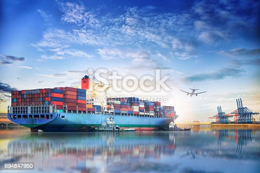 istock Logistics and transportation of International Container Cargo ship and cargo plane in the ocean at twilight sky, Freight Transportation, Shipping 694847950