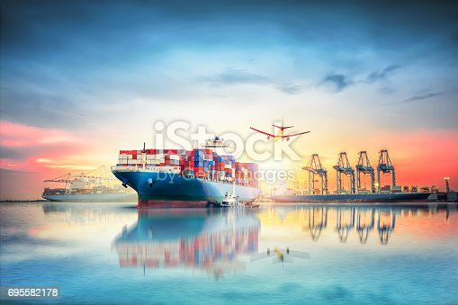693774520 istock photo Logistics and transportation of International Container Cargo ship and cargo plane in the ocean at twilight sky, Freight Transportation, Shipping 695582178