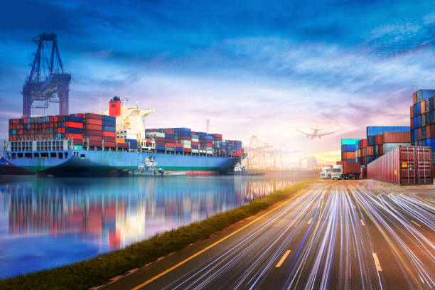 logistics and transportation of international container cargo ship and cargo plane in the ocean at twilight sky, freight transportation, shipping - harbor stock photos and pictures