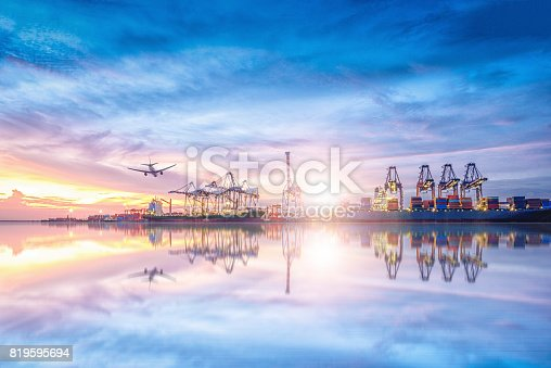 693774520 istock photo Logistics and transportation of International Container Cargo ship and cargo plane in the ocean at twilight sky, Freight Transportation, Shipping 819595694