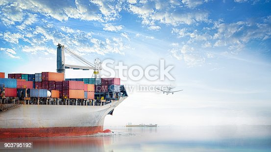 693774520 istock photo Logistics and transportation of International Container Cargo ship and cargo plane in the ocean at Sunset sky, Freight Transportation, Shipping 903795192