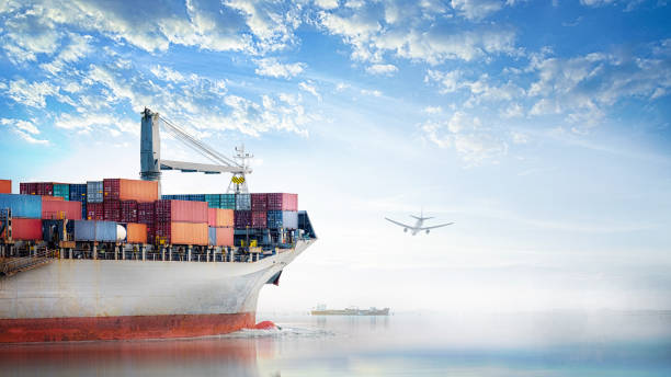 Logistics and transportation of International Container Cargo ship and cargo plane in the ocean at Sunset sky, Freight Transportation, Shipping stock photo