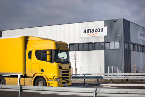 Logistics center of amazon in Raunheim-Moenchhof, Germany Facade of new logistics center of amazon in Raunheim-Moenchhof, Germany. Amazon (Amazon.com, Inc.) is an American electronic commerce and cloud computing company and the largest Internet retailer in the world as measured by revenue and market capitalization. In the foreground a passing freight truck amazon stock pictures, royalty-free photos & images