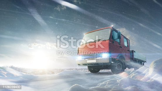 1127834626 istock photo logistics concept. Truck at wonderful countryside road at sunset in winter. Snowfall. Winter 1126239432