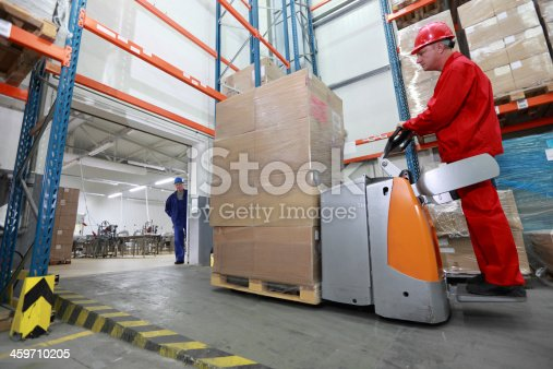 istock logistics - Goods delivery in storehouse 459710205