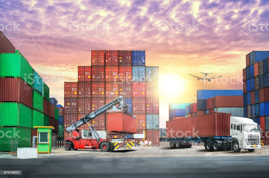 Logistics import export background and transport industry of Container Cargo freight ship at sunset sky royalty-free stock photo