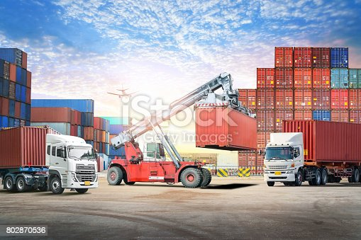 693774520 istock photo Logistics import export background and transport industry of forklift handling container box loading at seaport 802870536