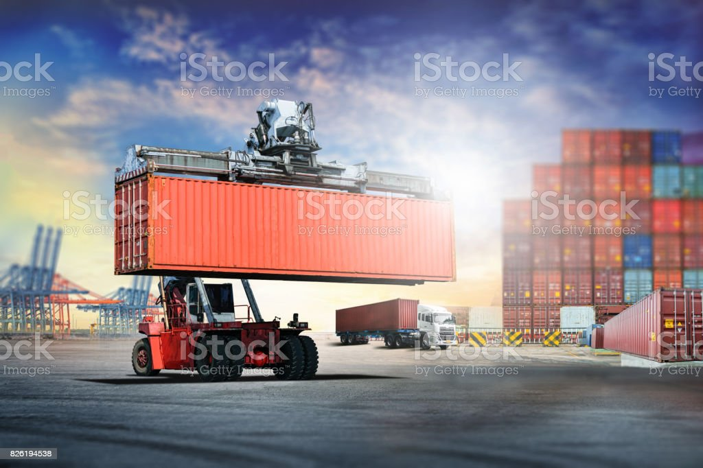 Logistics import export background and transport industry of forklift handling container box loading at port stock photo