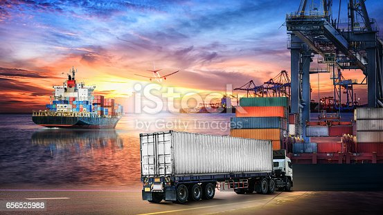 693774520 istock photo Logistics import export background and transport industry of Container truck and Cargo ship with working crane bridge in shipyard at sunset sky 656525988