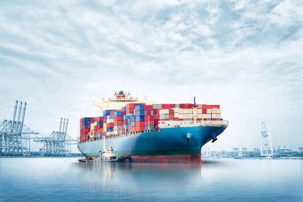 Logistics import export background of Container Cargo ship in seaport on blue sky, Freight Transportation Logistics import export background of Container Cargo ship in seaport on blue sky, Freight Transportation container ship stock pictures, royalty-free photos & images