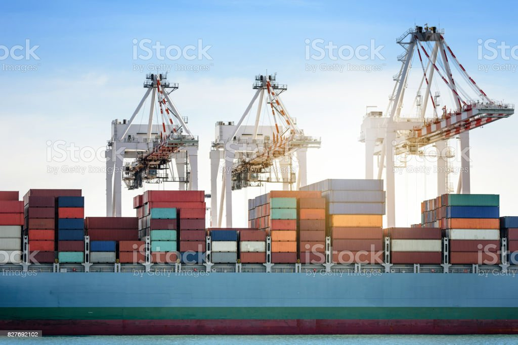 Logistics import export background of Container Cargo ship in seaport on blue sky, Freight Transportation stock photo