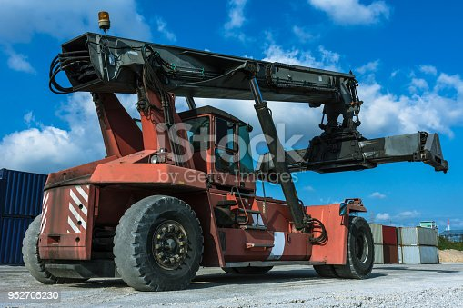 697974610 istock photo Logistics import export background of container handling forklifts at the dock. 952705230