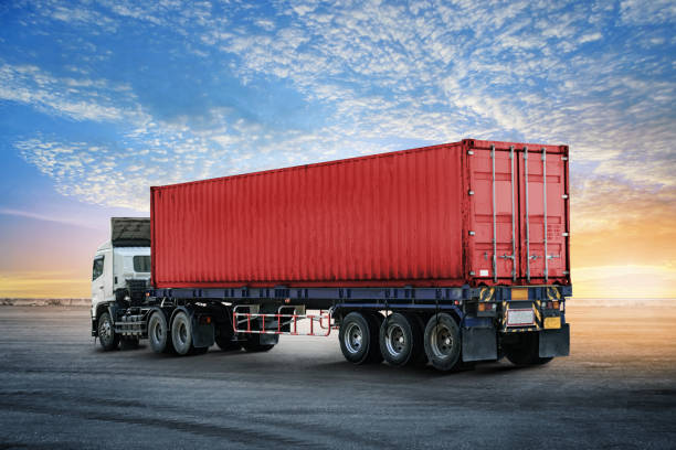 Logistics import export background of container truck at the dock stock photo