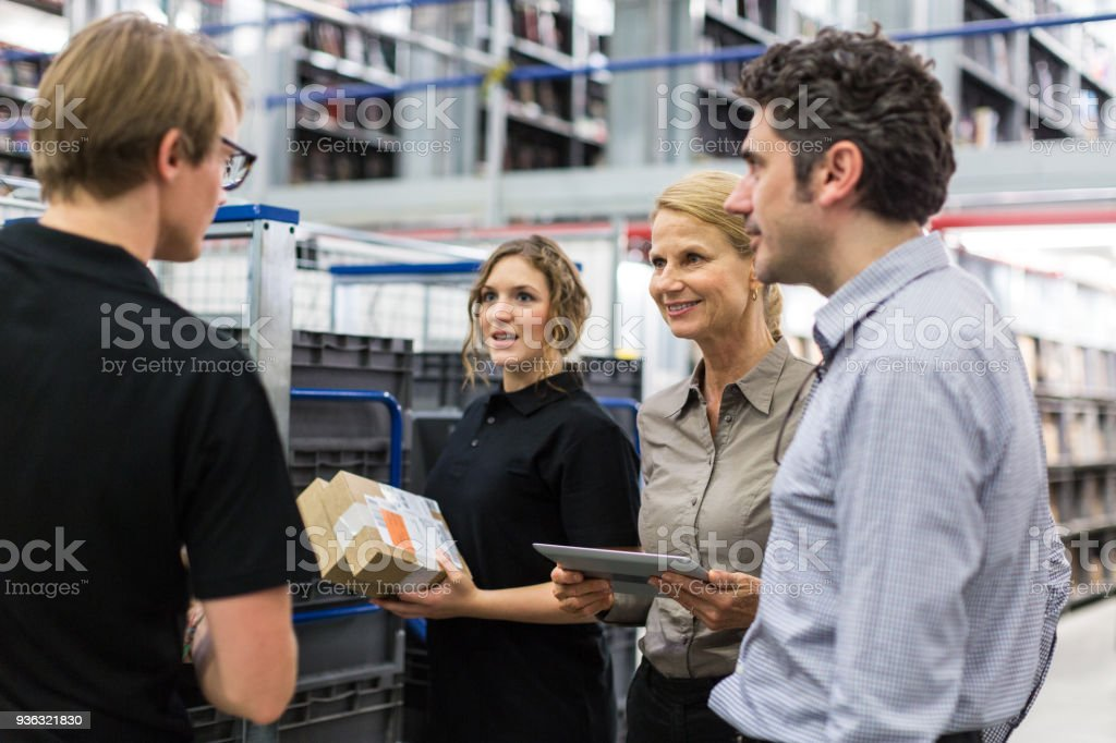 Logistics team discussing delivery schedules stock photo