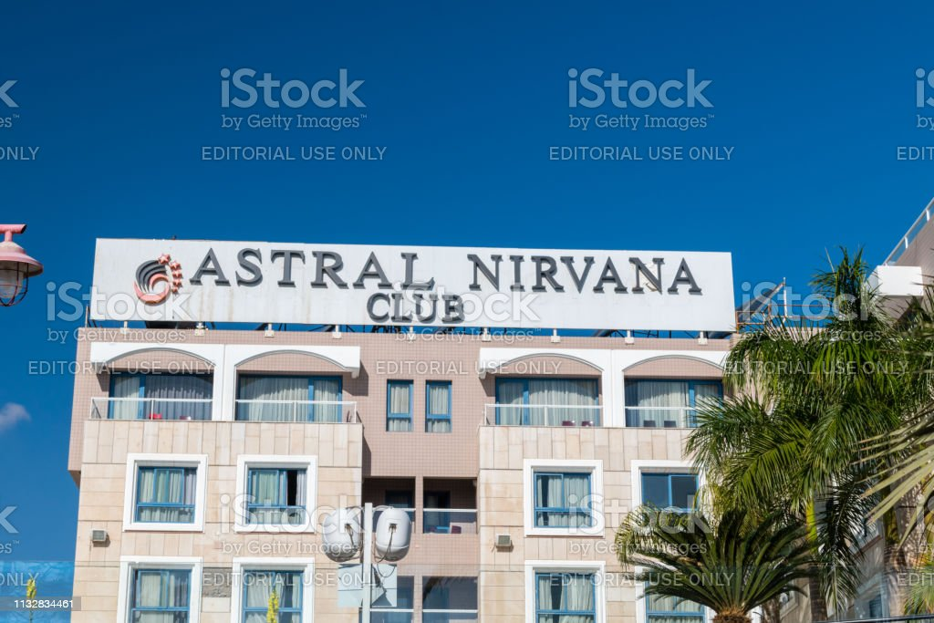 Logo and sign of Astral Nirvana Club hotel in Eilat. stock photo