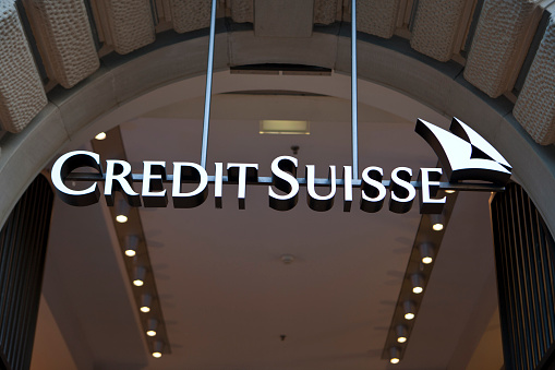 """Zurich, Switzerland - May 25, 2011: Logo of the bank Credit Suisse at Credit Suisse headquarters at Paradeplatz in the center of Zurich. The Credit Suisse Group was founded by Alfred Escher in 1856 as """"Schweizerische Kreditanstalt"""" (Swiss Credit Institution). After the merger with """"Schweizerische Volksbank"""" (Swiss Peoples Bank) it was renamed to Credit Suisse and is now a multinational financial services company including investment banking."""