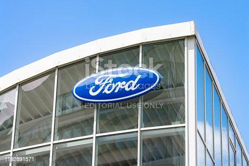 Frankfurt, Hesse/Germany - November 01, 2019: Ford logo on the glass facade of a car dealership